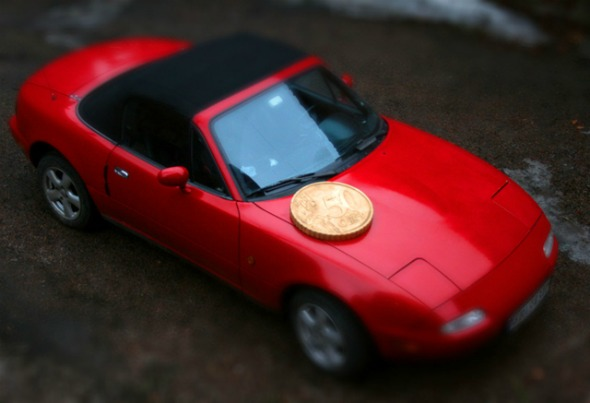 car with coin illusion