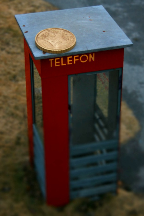 coin phone booth illusion
