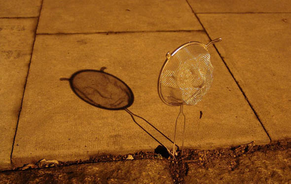 strainer-shadow-faces-made-from-colanders-isaac-cordal-41