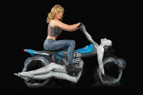 Woman on Motorcycle Optical Illusion
