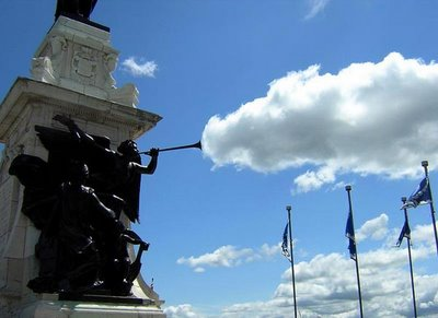 Statue Trumpet Blowing Away the Clouds Optical Illusion