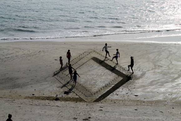 Climbing Stairs on the Beach Optical Illusion