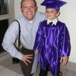 little graduate with a big hand optical illusion