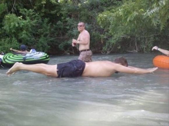 Man Using a Human Raft Optical Illusion