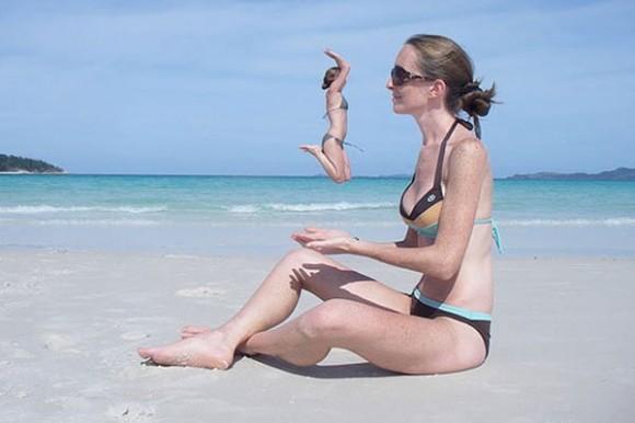 giant girl on the beach optical illusion