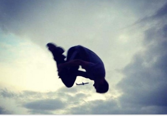 Man Jumping Over a Plane Optical Illusion