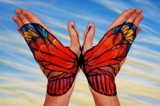 butterfly painted hands optical illusion