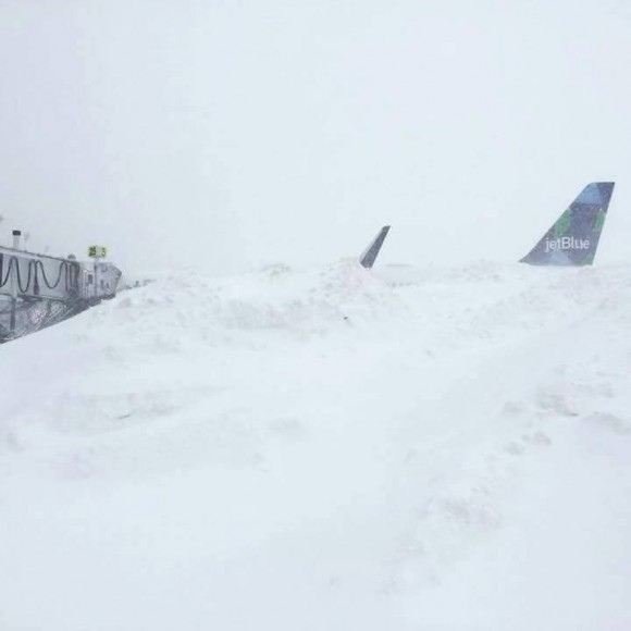jetblue plane buried in snow