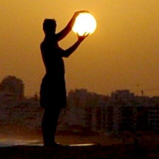 Man Holding a Sun Illusion