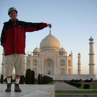 Man Holding a Taj Mahal Illusion