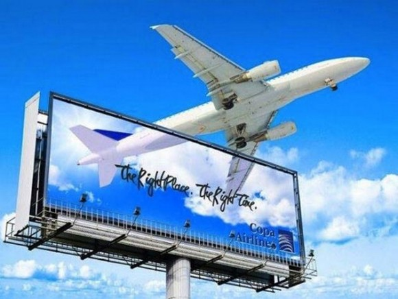 plane escaping a billboard optical illusion picture