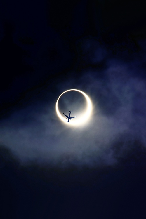 plane flying through the moon optical illusion