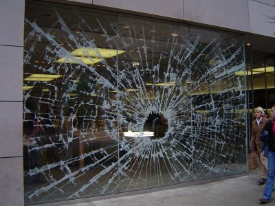 Broken window shop optical illusion for Broken glass mural